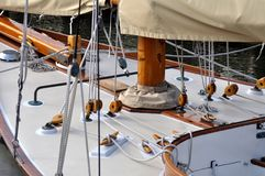 The Bow of a Wooden Sailboat. With ropes and pulleys and part of the Mast showing royalty free stock photo