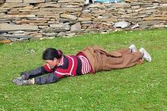 Bowed praying  tibetan girl Stock Photo