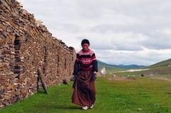 Bowed praying  tibetan girl Stock Photos