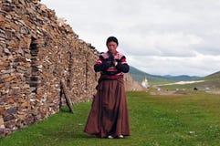 Bowed praying  tibetan girl Stock Image