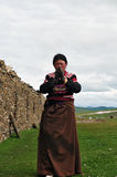 Bowed praying  tibetan girl Royalty Free Stock Images