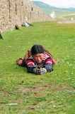 Bowed praying  tibetan girl Royalty Free Stock Images