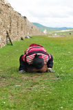 Bowed praying  tibetan girl Stock Photo