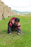 Bowed praying  tibetan girl Stock Photos