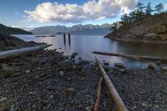 Bowen Island Long Exposure Mountains. Driftwood along Cates Beach, Bowen Island, BC, Canada Stock Images