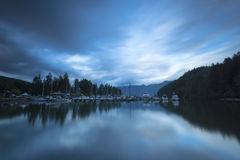Bowen Island Long Exposure Mountains. Snug Cove with some moody clouds, Bowen Island, BC, CANADA Stock Images