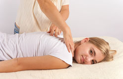 Bowen masage therapy of a young woman Stock Images