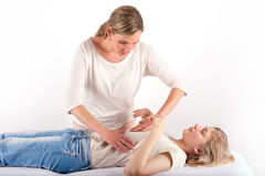 Bowen treatment of a girl Stock Images