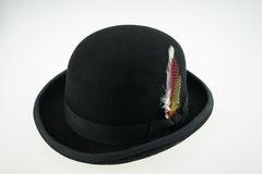 Bower hat with feather. Black bower hat with feather Royalty Free Stock Images