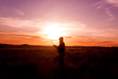 Bowhunter Checking Arrow at Sunset Royalty Free Stock Image