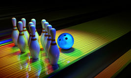 Bowing ball and skittles on the alley. Royalty Free Stock Photography
