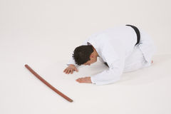 Bowing male in Karate uniform. Bowing young male in Karate uniform royalty free stock photography