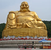 Bowing to the Giant Golden Buddha Stock Photography