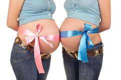 Bowknots on belly. Two pregnant women with bowknots on their belly Stock Images