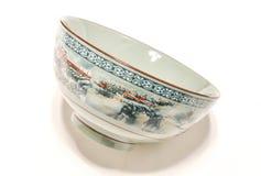 China ceramics bowl. Closeup of empty Chinese porcelain bowl, white background Royalty Free Stock Image