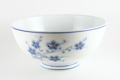 Floral Chinese bowl. Closeup of empty Chinese porcelain bowl with floral decoration, white background royalty free stock photos