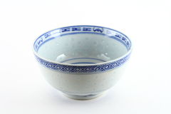 Asian rice bowl. Traditional Asian rice bowl with decorative blue pattern, white background Royalty Free Stock Images