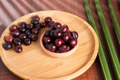 Acai berry. on a wooden background stock photos