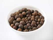 Bowl of allspice berries. On white background stock photography
