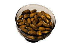 Bowl of Almonds. A grey glass bowl of almonds Stock Photo