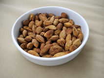 Bowl of almonds on canvas Royalty Free Stock Photography