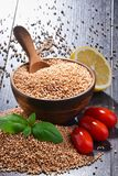 Bowl of amaranth grain on wooden table Stock Photo