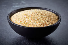 Bowl of amaranth seeds Royalty Free Stock Photography