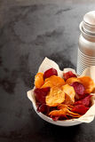 Bowl of appetizing crisp beetroot chips Royalty Free Stock Image
