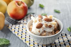 Bowl with apple crisp and ice cream. On table Stock Photography