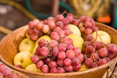 Bowl with apples and grapes. Stock Photo
