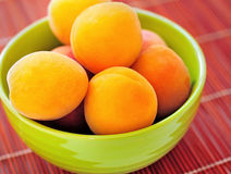 Bowl with apricot Stock Photos