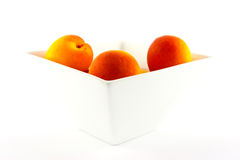 Bowl of Apricots. On a white background with clipping path Royalty Free Stock Photos