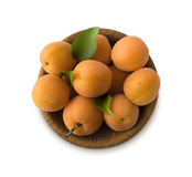 Bowl with apricots isolated on white background. Royalty Free Stock Photography