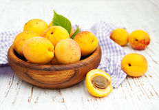 Bowl with apricots. On a old wooden background royalty free stock images