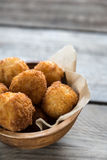 Bowl of arancini. Rice balls with mozzarella Stock Photos