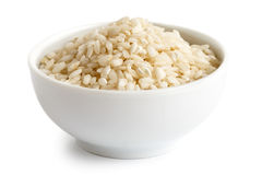 Bowl of Arborio short grain white rice. Bowl of Arborio short grain white rice  on white Royalty Free Stock Photography