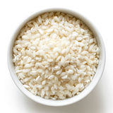 Bowl of Arborio short grain white rice  on white from ab Stock Image