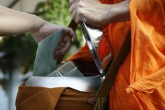 Monk during offering Stock Image