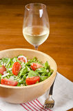 Bowl of Arugula and a Glass of White Wine #1 Royalty Free Stock Photos