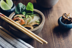 Bowl of Asian Noodle Soup with chopsticks Royalty Free Stock Image