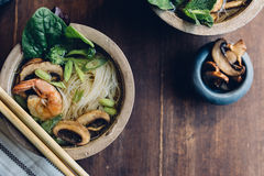 Bowl of Asian Noodle Soup with chopsticks Stock Image