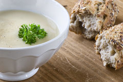 Bowl of asparagus soup. With chervil on wooden table. Grainy bread on background.  Health food Stock Photo