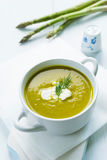 Bowl of asparagus soup topped with fresh cream and dill Royalty Free Stock Image