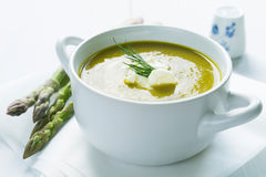 Bowl of asparagus soup topped with fresh cream and dill Stock Photography