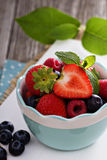 Bowl with assorted berries Stock Photos