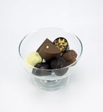 Bowl assorted chocolates. Glass bowl with a selection of assorted chocolates Royalty Free Stock Photo