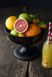 Bowl of assorted fresh citrus fruit Royalty Free Stock Photos