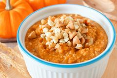 Bowl of autumn pumpkin oatmeal close up Stock Photos