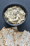 Bowl of baba ghanoush with matzo Stock Images