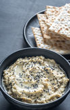 Bowl of baba ghanoush with matzo Stock Photography
